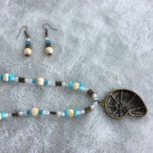 Love Beads Jewelry - Bronze nautilus crystal imbedded pendant necklace